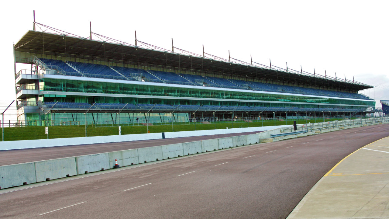 The ¼ Kilometre long Grandstand at Rockingham Motor Speedway Corby Northampton UK.
