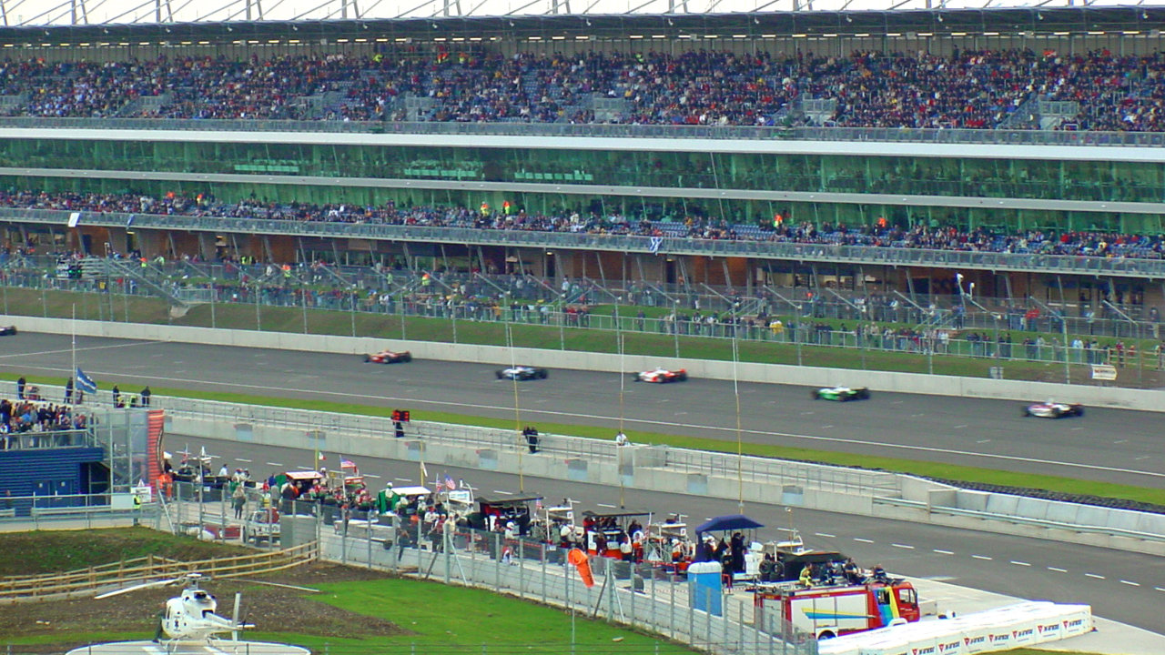In this shot American Champ Auto Racing Team Cars are passing the Grandstand at about 220mph
